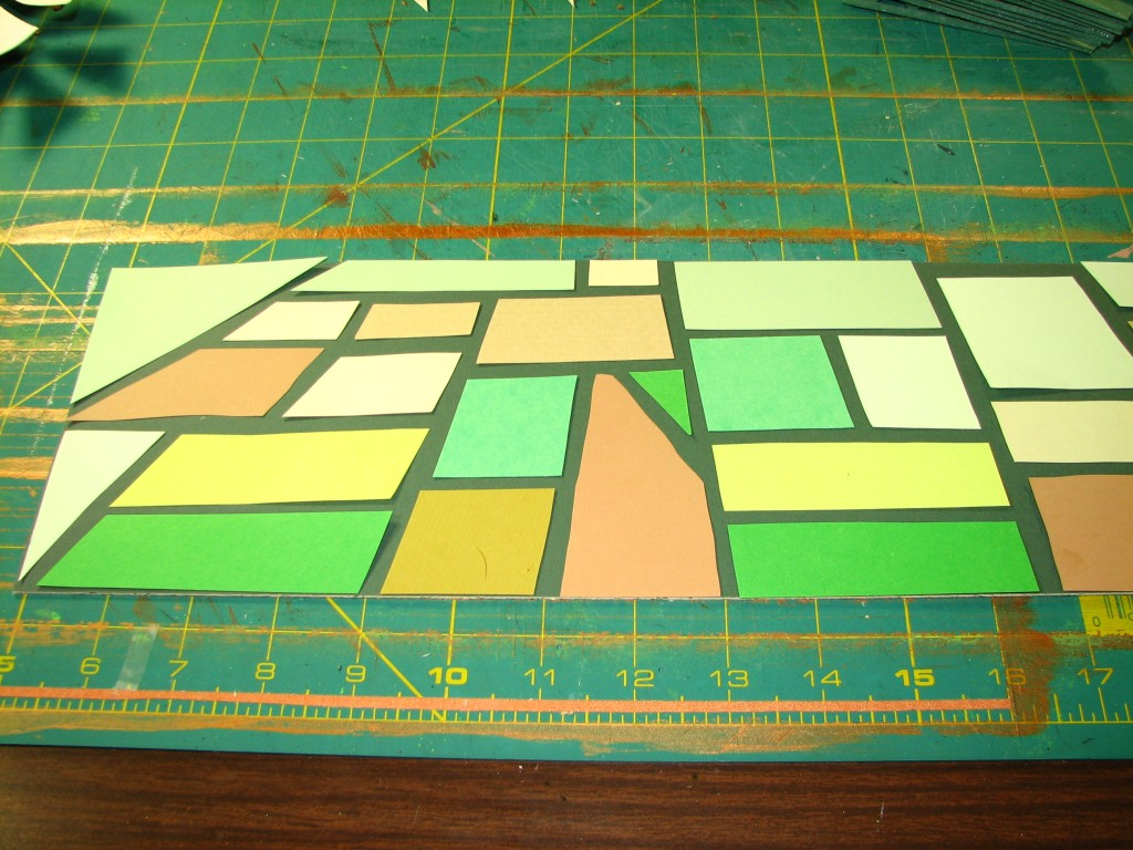 """Farmland"" cut from scrap paper"