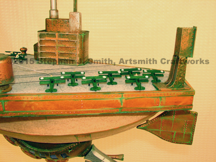 Close up of the biplanes on the deck of a steampunk airship aircraft carrier sculpture built by Stephan J Smith of Artsmith Craftworks.
