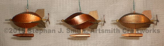 Photo of a set of three steamunk airship Christmas ornaments. Colors, metallic copper, bronze and brass.
