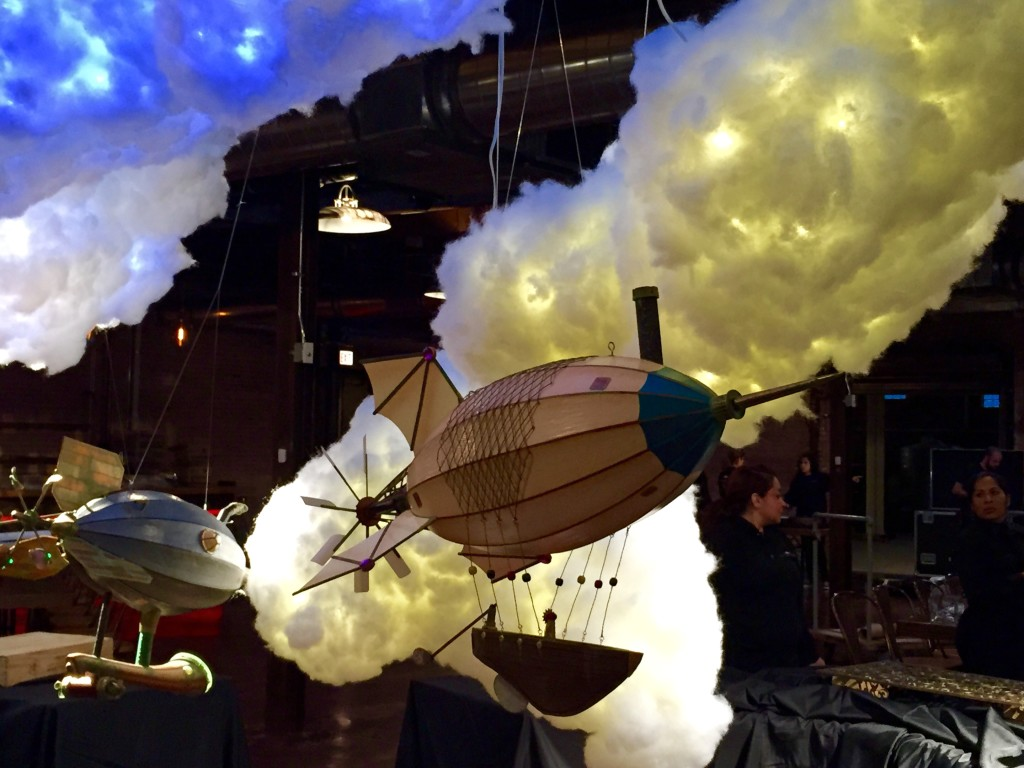 Photos of steampunk airships by Artsmith Craftworks hanging in place at the 2015 Google Holiday Party in Chicago.