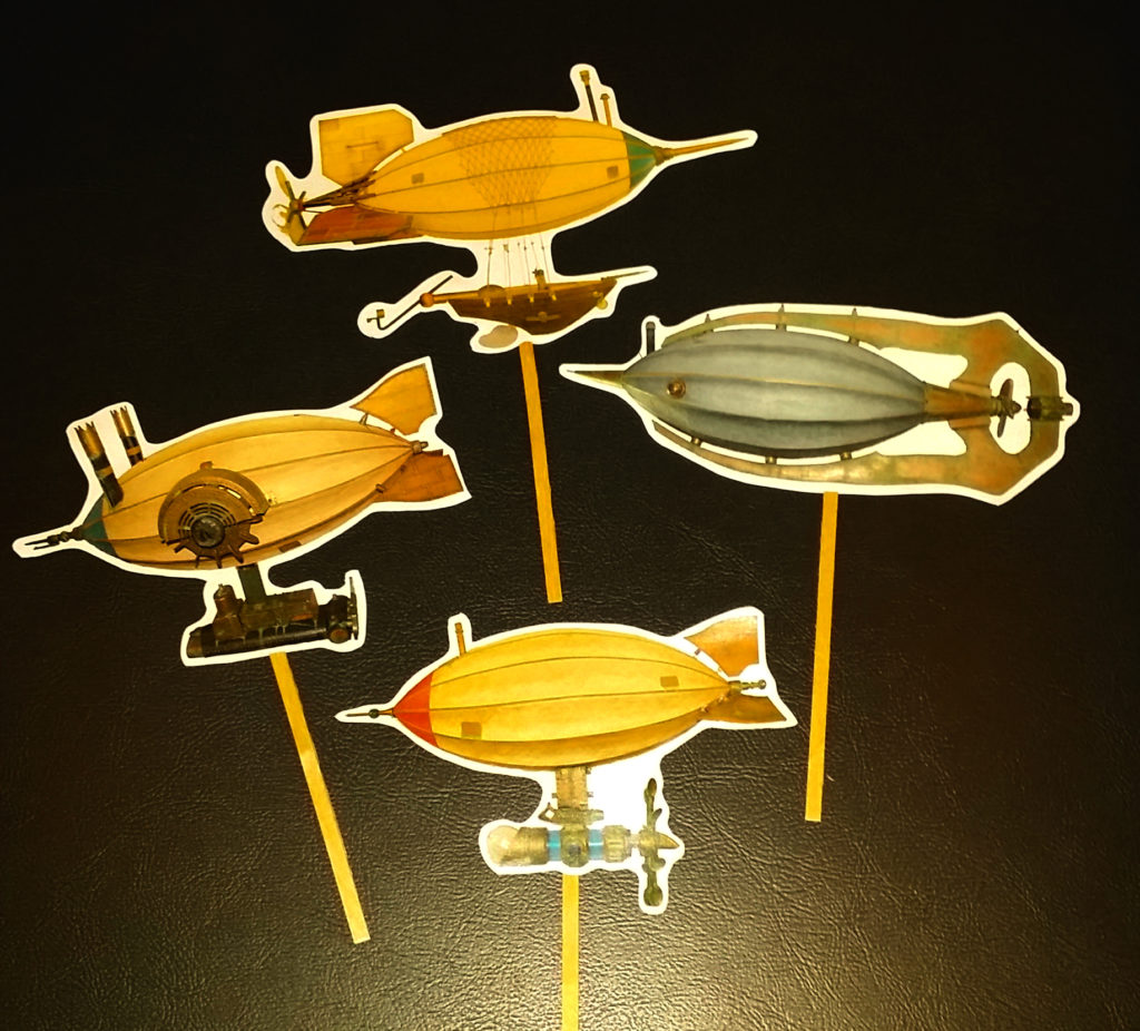 Photo of a group of steampunk airship photo cutouts on a stick to be used in selfies.