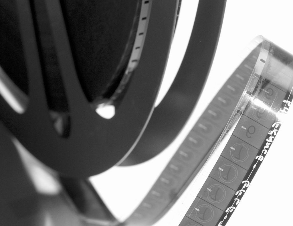 Black and white photo of a reel of film showing a loop close-up.